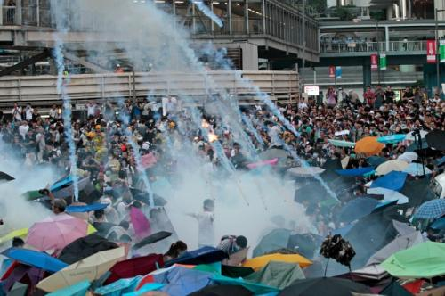 Hong Kong Police Tear Gas…